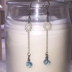 Handmade long white and baby blue earrings.